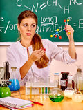 Chemistry teacher at classroom Royalty Free Stock Image
