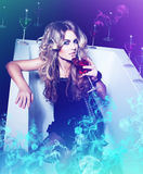 Chemistry woman with wine and other glasses Royalty Free Stock Photography