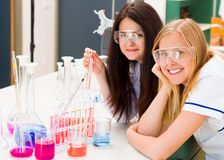 Chemists with experiments Stock Photos
