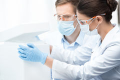 Chemists in protective workwear making experiment with liquid nitrogen Royalty Free Stock Images