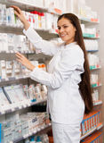 Chemists shop. Woman pharmacist at the chemists shop royalty free stock photo