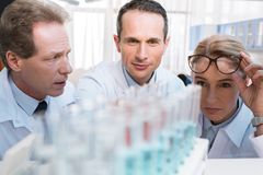 Chemists with test tubes Stock Images