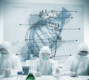Chemists working with futuristic interface showing heart and DNA Stock Photo