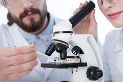 Chemists working with microscope Stock Photos