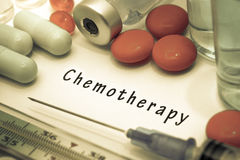 Chemotherapy. Diagnosis written on a white piece of paper. Syringe and vaccine with drugs stock images