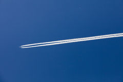 Chemtrail or Vapor trail Stock Photography