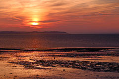 Chemtrails au coucher du soleil Image libre de droits