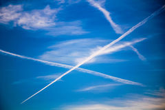 Chemtrails on Blue Sky. White chemtrails on blue sunny sky in spring Royalty Free Stock Photo