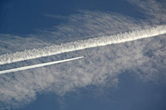 Chemtrails in sky. Photo of sky filled with chemtrails contrails from aeroplanes Royalty Free Stock Photos