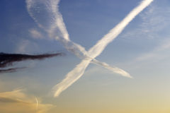 Chemtrails at sunset Royalty Free Stock Images