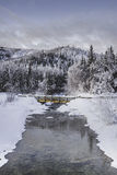 Chena hot springs. A shot of clear water from a hot spring flowing through a snow covered landscape royalty free stock images