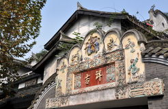 Chengdu, China: 18th Century Gate Tympanum. A finely restored home and magnificent 18th century entrance gate bas relief tympanum panel covered with handsome Stock Image