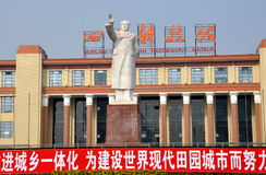 Chengdu, China: Chairman Mao Zedong Statue. A larger-than-life white statue of Chairman Mao Zedong with uplifted arm stands in front of the Sichuan Science and Royalty Free Stock Photography
