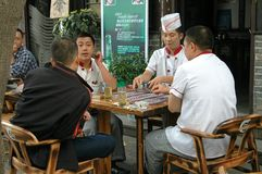 Chengdu, China: Chefs Playing Cards Royalty Free Stock Image