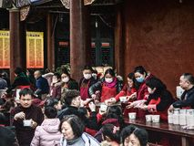 Chinese New Year Celebration. Chengdu, China - 05 February 2019: Volunteers handing out free food at Chinese New Year stock images