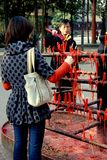 Chengdu, China: Lighting Incense at Buddhist Temple Royalty Free Stock Image