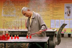 Chengdu, China: Man Lighting Incense at Temple Royalty Free Stock Photography