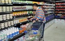 Chengdu, China: Man Shopping in Supermarket Royalty Free Stock Photography