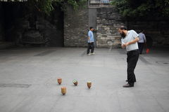 Chengdu, China: Man Spinning Top Stock Photos
