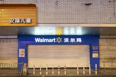 Walmart store entrance at night. Chengdu, China - September 29, 2017: Walmart store entrance at night. Walmart Stores, Inc. was founded by American Mr. Sam Stock Images