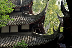 Chengdu, China: Wenshu Temple Flying Eave Roofs. Historic drum tower and prayer hall with their distinct tiled flying eave roofs at the 17th century Wenshu Stock Image