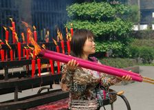 Chengdu, China: Woman Carrying Incense Sticks Stock Images