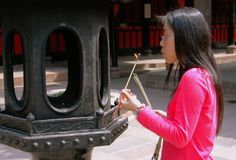 Chengdu, China: Woman Lighting Incense Stock Image