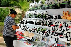 Chengdu, China: Woman Selling Stuffed Panda Toys Royalty Free Stock Photography