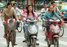 Chengdu, China: Women Riding Mopeds Stock Photos