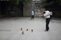 Chengdu, Cina: Trottola dell'uomo Fotografie Stock