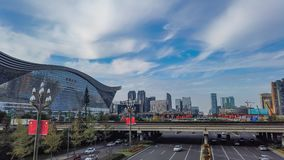 Timelapse of moving clouds above Global Center - Chengdu stock video footage
