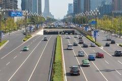 Car traffic on TianFu avenue in Chengdu. Chengdu, Sichuan Province, China - Sept 21, 2018 : Car traffic on Tianfu avenue with Chengdu south skyline royalty free stock image
