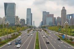 Traffic on Tianfu avenue in Chengdu. Chengdu, Sichuan Province, China - Sept 13, 2018 : Car traffic on Tianfu avenue with Chengdu south skyline royalty free stock images