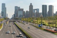 Car traffic on TianFu avenue in Chengdu. Chengdu, Sichuan Province, China - Sept 21, 2018 : Car traffic on Tianfu avenue with Chengdu south skyline stock image