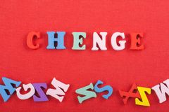 CHENGE word on red background composed from colorful abc alphabet block wooden letters, copy space for ad text. Learning Stock Photo