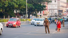 CHENNAI, INDIA - JANUARY 2018 :Traffic police controlling the vehicles on the road. Passengers and commuters in the downtown of Ch stock photo