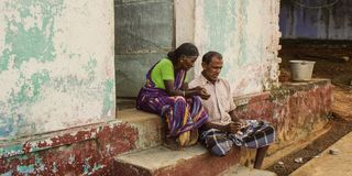 CHENNAI, INDIA - SEPTEMBER 28th, 2018: couple of senior people siting on the house exterior step royalty free stock images