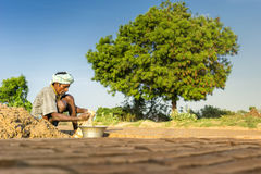 Chennai, Inida- August 4 2017; Old man working in brick factory, Stock Photography