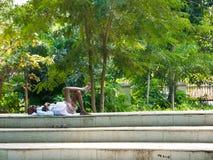 Man taking a nap in a public park of Chennai. Chennai, Tamil, Nadu, India. January 14, 2018. Man taking a nap in a public park of Chennai Stock Photo