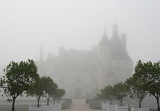 Chenonceau castle in fog. Loire, France Stock Photography