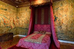 CHENONCEAU, FRANCE - CIRCA JUNE 2014: Five Queens` bedroom in Chateau Chenonceau. CHENONCEAU, FRANCE - CIRCA JUNE 2014: Beautiful interior of Five Queens` royalty free stock photo
