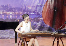 Chenyingjia ( 陈盈嘉 ) play zither. Teacher chenyingjia of xiamen xinghe ( 星河 ) art center playing guzheng, amoy city, china Royalty Free Stock Photography