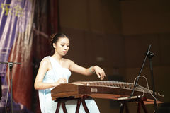 Chenyingjia play zither. Teacher chenyingjia ( 陈盈嘉 ) of xiamen xinghe ( 星河 ) art center playing guzheng, amoy city, china Stock Photography