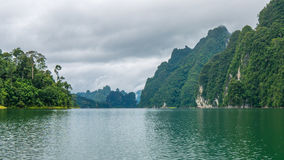 Cheo Lan Lake in Khao Sok, Suratani, Thailand.Rainy Clouds. Cheo Lan Lake in Khao Sok, Suratani, Thailand. Rainy Clouds. Low Season Royalty Free Stock Image
