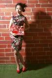 Cheongsam et femmes asiatiques photographie stock libre de droits