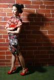 Cheongsam et femmes asiatiques images stock