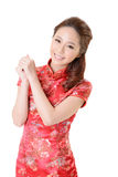 Cheongsam woman. Smiling Chinese woman dress traditional cheongsam at New Year, studio shot isolated on white background Stock Images
