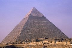 Cheops Pyramid near Cairo, Egypt. Probably the most photographed pyramid in the world.  They are still exploring the inside of the pyramid.  The sphinx is right Stock Images