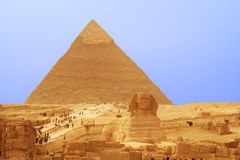 Cheops pyramid and sphinx Royalty Free Stock Photo