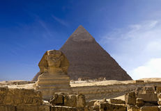 Cheops Pyramid And Sphinx In Giza. The famous ancient Egypt Cheops pyramid and sphinx in Giza Stock Photo